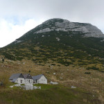 The shepherd huts near Kal's saddle. In the background is Tolminski Migovec summit.