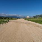 The paved road on Dugo Polje plateau