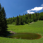 The small lake on Raduša mountain is situated near the trail.