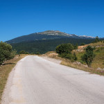 The paved road section. In the background is Klekovača mountain.