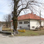 The school and fountain in the village Potok Musulinski