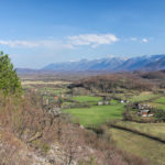 Trnovac village and in the background there is Velebit mountain.