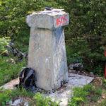 The trig point at Crni Vrh peak on Grmeč mountain