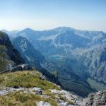 The view from Maglić peak in Bosnia and Herzegovina. Below is the lake Trnovačko Jezero in Montenegro.